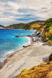 HDR image of a secluded beach on Skiathos island on a cloudy day Royalty Free Stock Photography