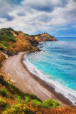 HDR image of a secluded beach on Skiathos island on a cloudy day Royalty Free Stock Image