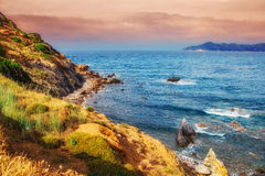 HDR image of a secluded beach on Skiathos island on a cloudy day Stock Photo