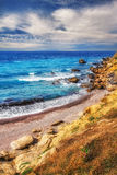 HDR image of a secluded beach on Skiathos island on a cloudy day Stock Photos