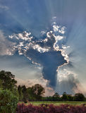 HDR image of a tall cloud with sunbeams Stock Photography
