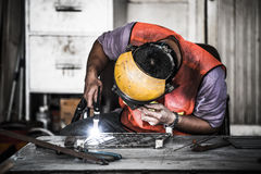 HDR image of a technician using tig welder in factory's workshop Royalty Free Stock Photography