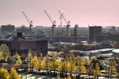 HDR Image View from Fujimi Kawasaki. View of Industries , smoke , Cranes working on bright Sunday morning with Autumn trees all over Stock Photography