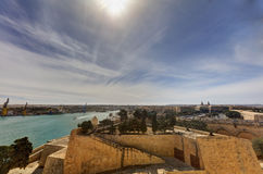 HDR image of a view on the Valletta harbor from the historic Upper Barraka garden area in Malta.  Stock Photo