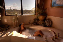 HDR image of a woman in the bath Stock Photos