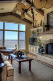 HDR of living room overlooking lake Stock Photography