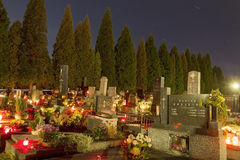 HDR long exposure night image of a small village cemetery in Paskov with decorations and candles burning on All Saints Day in CZ Stock Image