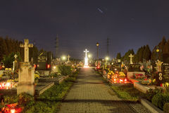 HDR long exposure night image of a small village cemetery in Paskov with decorations and candles burning on All Saints Day in CZ Royalty Free Stock Image