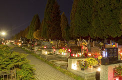 HDR long exposure night image of a small village cemetery in Paskov with decorations and candles burning on All Saints Day in CZ Stock Photos