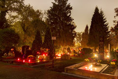 HDR long exposure night image of Vitkovice cemetery with decorations and candles burning on graves during the All Saints Day in CZ Royalty Free Stock Image
