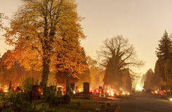 HDR long exposure night image of Vitkovice cemetery with decorations and candles burning on graves during the All Saints Day in CZ Stock Image