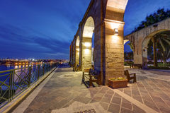 HDR night view on the Grand Valletta harbor from the Upper Baraka garden and with the decorative stone arches Royalty Free Stock Photography