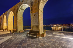 HDR night view on the Grand Valletta harbor from the Upper Baraka garden and with the decorative stone arches Stock Image