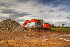 HDR of orange excavator Royalty Free Stock Photography