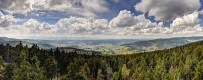 HDR panorama with forest mountains and cloudy sky. Beautiful HDR panorama with forest mountains and cloudy sky Royalty Free Stock Photos