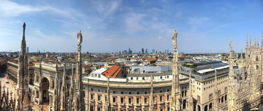 HDR panorama photo of marble statues of Cathedral Duomo di Milano on piazza, Milan cityscape and Galleria Vittorio Emanuele II Stock Photography
