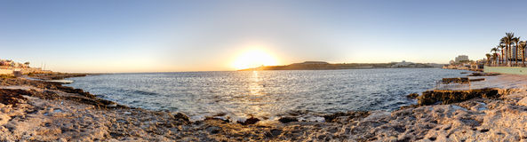 HDR panorama photo of sunrise behind sea  at Malta, St. Paul Royalty Free Stock Photography