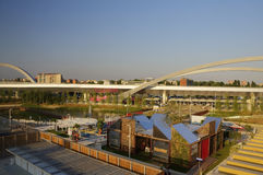 HDR panorama photo of the view from the top of the large Russian pavilion at the Milan EXPO 2015 with a bridge in the background Stock Photography