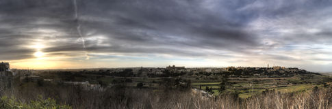 HDR panorama View on the surrounding nature of Mdina city, Malta, and dynamic skies at sunset time Royalty Free Stock Image