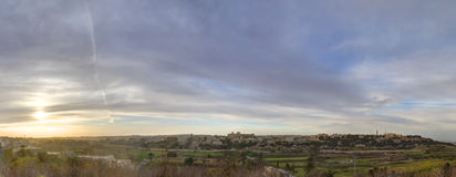 HDR panorama View on the surrounding nature of Mdina city, Malta, and dynamic skies at sunset time Royalty Free Stock Photography