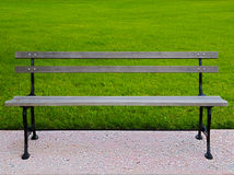HDR park bench. HDR photo image of a park bench on a lawn Stock Photography