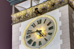 HDR photo of a detail on the Olomouc town hall towers clock at night with christmas decoration Royalty Free Stock Photography