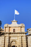HDR photo of an entrance gate and city walls of the famous Mdina city, Malta, on a sunny summer afternoon.  Stock Photos
