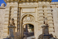 HDR photo of an entrance gate and city walls of the famous Mdina city, Malta, on a sunny summer afternoon.  Royalty Free Stock Photo