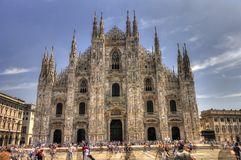 HDR photo of the famous Cathedral Duomo and people in front of it on a sunny day Stock Photo