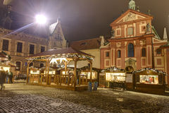 HDR photo of the first ever traditional Christmas markets at the Prague castle behind the Metropolitan Cathedral of Saints Vitus Royalty Free Stock Photos