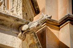 HDR photo of a historic stone gargoyle on the edge of an old house in Mdina city, historic capital of Malta Stock Images