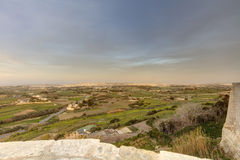 HDR photo of Malta landscape from the top of the historic city Mdina in late afternoon sun.  Royalty Free Stock Photography