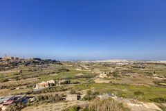 HDR photo of Malta landscape from the top of the historic city Mdina in late afternoon sun on a sunny day.  Royalty Free Stock Images