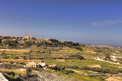 HDR photo of Malta landscape from the top of the historic city Mdina in late afternoon sun on a sunny day.  Royalty Free Stock Photography
