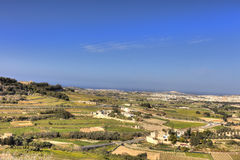 HDR photo of Malta landscape from the top of the historic city Mdina in late afternoon sun on a sunny day.  Royalty Free Stock Image