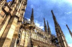 HDR photo of the marble statues and decorations on the Cathedral Duomo di Milano on piazza in Milan Stock Image