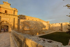 HDR photo of Mdina city historic walls and the entrance gate during sunset Stock Image