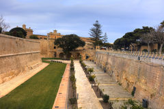 HDR photo of Mdina city historic walls. Mdina is the former historic capital of the Malta island Stock Photos