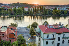 HDR photo of Prague cityscape and Vltava river flowing through the city center with sunset over the horizon Royalty Free Stock Photos
