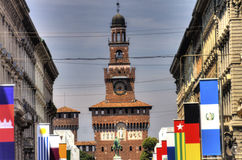 HDR photo of the Sforza Castle in Milan with the main street and flags in front of it Royalty Free Stock Photography