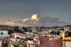 Pink cloud above the HDR italian city roofs. HDR photo of small italian city roofs under a big dark cloud Stock Photography