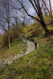 HDR photo of stairs leading up the hill in a park during late spring Royalty Free Stock Image