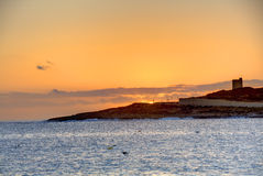 HDR photo of sunrise behind sea  at Malta, St. Paul Royalty Free Stock Image