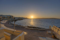 HDR photo of sunset behind sea on the horizon at Malta, St. Paul Stock Image