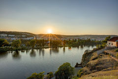 HDR photo of a view on Vltava river with sun setting behind it from Vysehrad in Prague, Czech republic Stock Photos