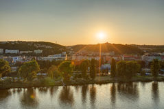 HDR photo of a view on Vltava river with sun setting behind it from Vysehrad in Prague, Czech republic Royalty Free Stock Image