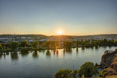 HDR photo of a view on Vltava river with sun setting behind it from Vysehrad in Prague, Czech republic Royalty Free Stock Photography