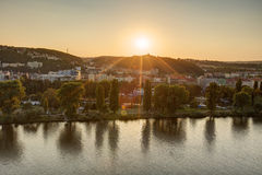 HDR photo of a view on Vltava river with sun setting behind it from Vysehrad in Prague, Czech republic Royalty Free Stock Photos