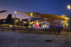 HDR photo of the visitors of Milan Expo at night Royalty Free Stock Photo