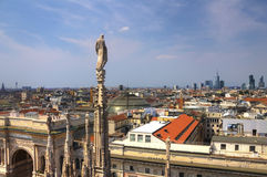 HDR photo of the white marble statues of Cathedral Duomo di Milano on piazza, Milan cityscape and Galleria Vittorio Emanuele II Stock Photography